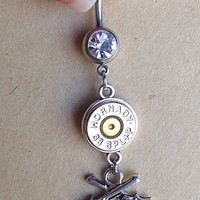 Bullet jewelry. Belly button ring with guns and bullet casing