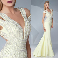 Sexy V Neck Prom Dresses 2017 Illusion With Pearls Crystal Daffodil Mermaid Open Back Floor Length Formal Party Evening Gowns