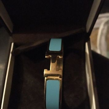 CREYON8Y Hermes H bangle in Blue and Gold