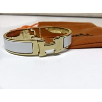 Hermes Gold and White H Clic Bracelet Size PM Tagre™