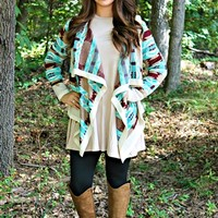 Once In A Lifetime Cardigan.Our gorgeous Once In A Lifetime Cardigan features a burgundy, taupe and turquoise Aztec pattern. It is the perfect sweater for a fall night out or a cozy night in by the fire place!