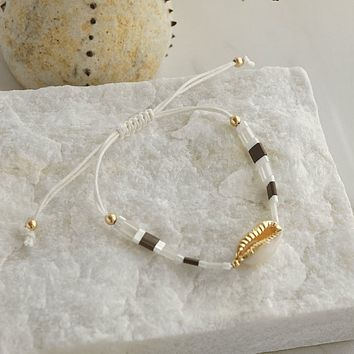 Friendship Bracelet with Cowrie shell in white