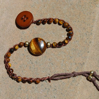 Tiger Eye bead crocheted bracelet with gold beads. upcycled vintage beads and lucite button