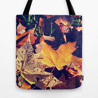 fall yellow, brown leaves falling on green grasses. Tote Bag by NatureMatters
