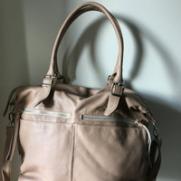 Tan leather tote. Weekend cross body bag. Lots of room, front pockets, fully lined with rope handles. Genuine leather, crossbody bag tote.