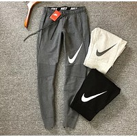 NIKE Fashion New Big Hook Print Leisure Sports Women And Men Sports Pants Dark gray
