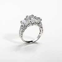 The Romantica, A Round Cut Heart Floral Three Stone Engagement Ring