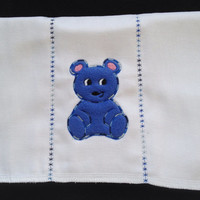 Blue Bear Applique in fleece embroidered on a  burp cloth. The seams have decorative stitches. Can be personalized for an extra charge.