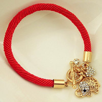 Red Bracelet With Elephant Pendant