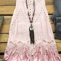 Our Walk The Line Top - Blush is just precious! It's a sleeveless tunic with eyelet detail and a satin bottom layer. We suggest wearing a cami for coverage. This top is see through due to the detail.