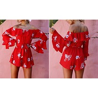 RED FLOWER POWER RUFFLED ROMPER