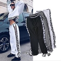 Fashion Women's new cross-side straps hollow pants trousers