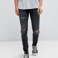 River Island Skinny Jeans With Rips In Black Wash at asos.com