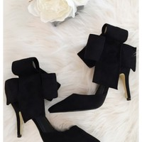 Bradshaw bow heels - Black bow high heels with above the ankle closure.