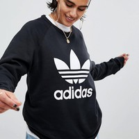 adidas Originals Black Trefoil Boyfriend Sweatshirt at asos.com