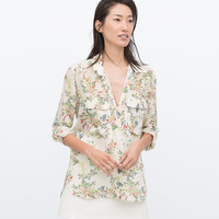 Printed blouse with pockets