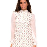 Motel Rocks crushing on vintage inspired styling this season! In a cute floral print this dress features dreamy sheer chiffon sleeves with ruffled cuffs, a high neck with a chiffon ruffled bib detail and finish with button up closured. Unlined. Style with