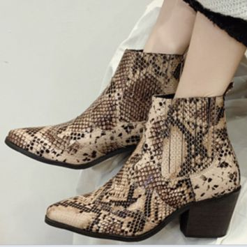 A new line of sexy, pointy, chunky boots with snakeskin stripes