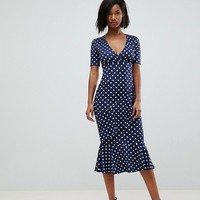 Club L Polka Dot Short Sleeve V Wrap Front Dress at asos.com