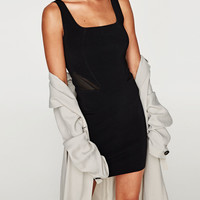 STRAPPY DRESS WITH SEAMS AT THE WAIST