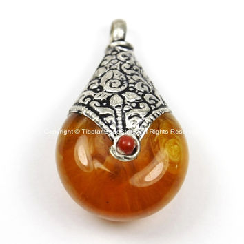 Reversible Tibetan Amber Resin Pendant with Tibetan Silver Caps, Repousse Lotus Flower Details & Red Colored Coral Inlays- WM5679B-1