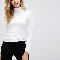 ASOS DESIGN turtleneck long sleeve top in white at asos.com