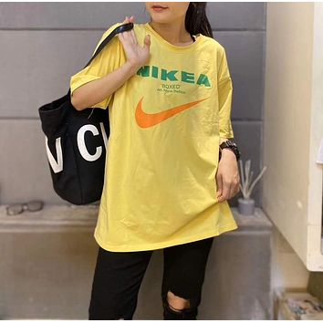 """""""NIKE"""" Woman Leisure Fashion Letter Personality Printing Loose Short Sleeve Motion Tops Skirt"""