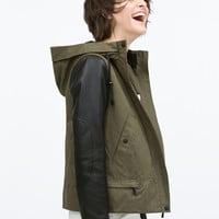 Hooded parka with leather effect sleeve