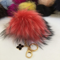 Fur pom pom keychain, bag pendant with flower charm in watermelon red with black markings color tone