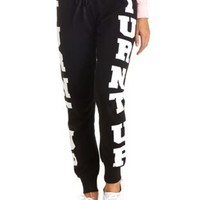 Turnt Up Graphic Skinny Sweatpants by Charlotte Russe - Black Combo
