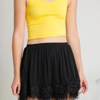 This super cute slip on style mini skirt features pleated gauze crinkle fabrication, a-line cut, crochet lace trim and tulle accent, and elastic waist band. Fully Lined. Pair with Criss-Cross Plunging V-Neck 2 tone Leatherette bodysuit in black and Jeffrey