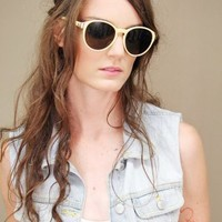 pale yellow sunglasses with rounded lenses and gold tipped frames | shopcuffs.com