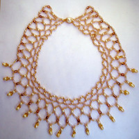 Beaded necklace in net pattern with faux pearls and freshwater drop pearls.