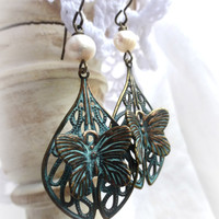 Green patina butterfly filigree and pearl earrings.