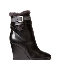 Fendi Shearling Wedge Boots - ShopBAZAAR