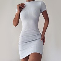 Pure color slim slim sexy  short sleeve bag hip dress white