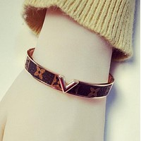 LV Stylish Women Men New Simple Titanium Steel Rose Golden Print Bracelet Jewelry