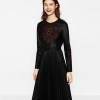 EMBROIDERED DRESS WITH PLEATED SKIRT DETAILS
