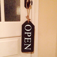 "Wooden tag with rope hanger.  Open on one side and Close on the other.  16""x6""x3/4"""