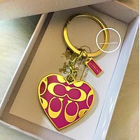 COACH Stylish Women Men Delicate Heart Pattern Hanging Drop Car Key Chain Bag Accessories