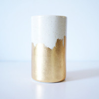spotted vessel with gold brush strokes