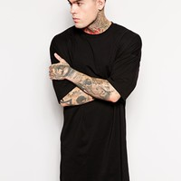 ASOS Super Longline T-Shirt With Oversized Fit And Stepped Hem at asos.com