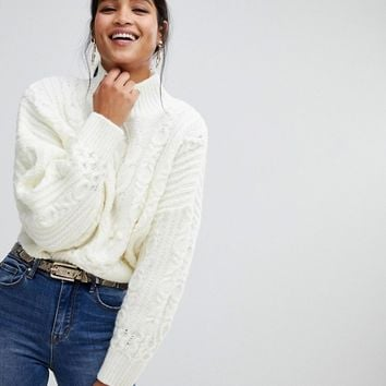 ASOS DESIGN crop cable sweater with volume sleeve at asos.com