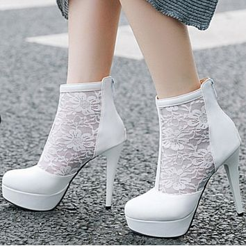 The new style is a hot seller of simple and versatile waterproof table lace face high heels after narrow zipper ankle boots