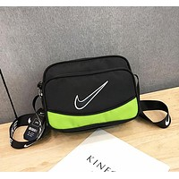 NIKE New fashion hook print couple contrast color shoulder bag