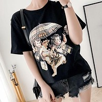 BURBERRY Fashion Women Men Casual Cupid Umbrella Classic Plaid Angel Print Round Collar T-Shirt Top Black
