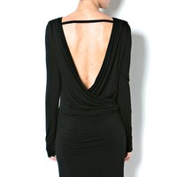 This super stretchy over the knee dress features a round neckline, slip on style, drape & ruched detailing at waist, long sleeves, form fitting skirt design with an open back with draped overlapping design and a single strap at shoulder.
