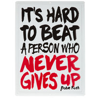 A Person Who Never Gives Up Embossed Tin Sign | Hobby Lobby | 5696281