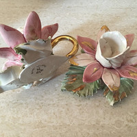 Pair of Capodimonte  candle holders in a lotus flower motif in gorgeous pinks whites greens and golds.