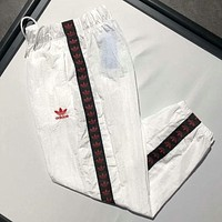 Adidas Fashion new string mark print embroidery leisure sports women and men trousers pants White